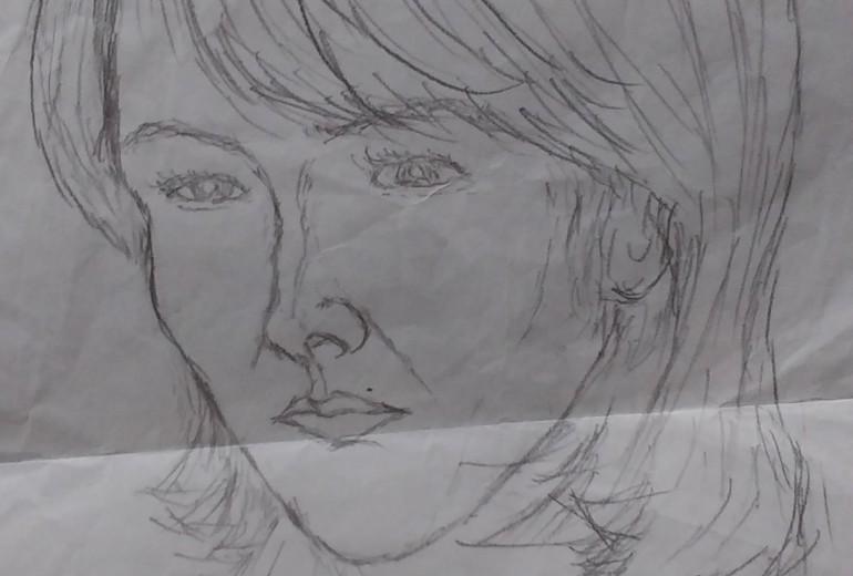 女性の似顔絵。