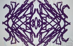 左紫色マーク - 池田 旬