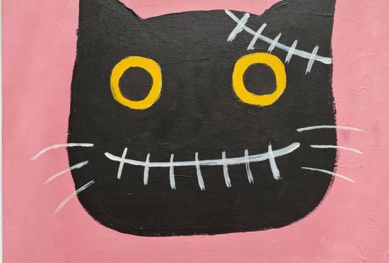 傷のある黒猫